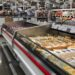 FOLSOM, CALIFORNIA, USA - OCT 3, 2017: Costco wholesale warehouse shopping aisle for cheesed refrigerated items,  a members only club.